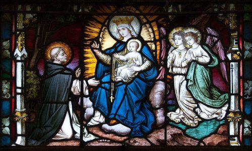 Santo Domingo recibe el rosario de Maria