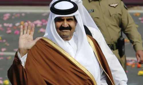 Qatari Emir Sheikh Hamad bin Khalifa al-Thani waves as he arrives to attend National Day celebrations in Doha December 18, 2012. REUTERS/Fadi Al-Assaad (QATAR - Tags: POLITICS ANNIVERSARY)