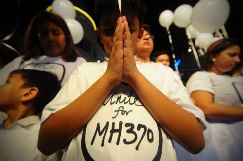 ceremonia ecumenica en malasia por el vuelo desaparecido