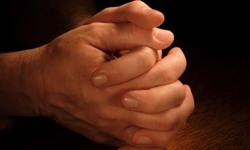 manos orando
