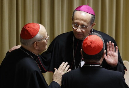 Cardinal Erdo talks with Archbishop Forte before morning session of extraordinary Synod of Bishops on the family at Vatican