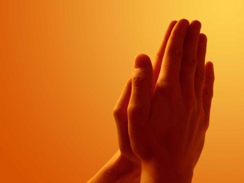 manos orando fondo